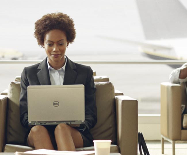 woman on Dell laptop