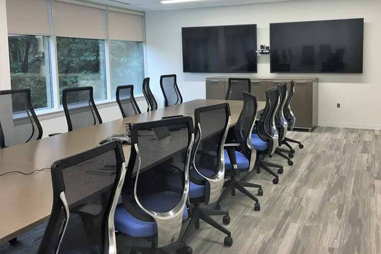 "Dual 80"" monitors with video conferencing"