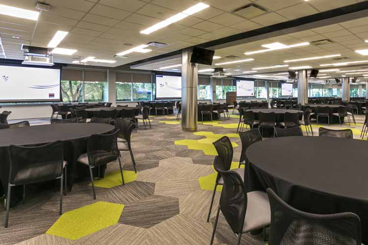 Large venue meeting space with four 10,000 lumen laser projectors, reinforced audio zoning